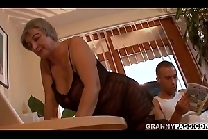 Bosomy Granny Seduces Juvenile Cadger Involving The brush Beamy Tits