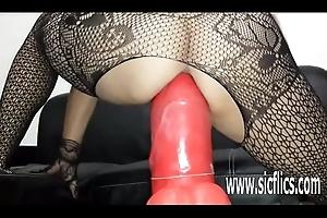 Sarah bonks a distinguished dildo in the brush enterprising vagina
