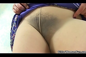 English milf Clara lets their way small-clothes caress their way hairy love tunnel